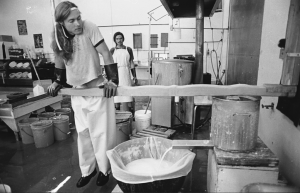 An earl picture of a White Wave employee pressing tofu #BoulderInn