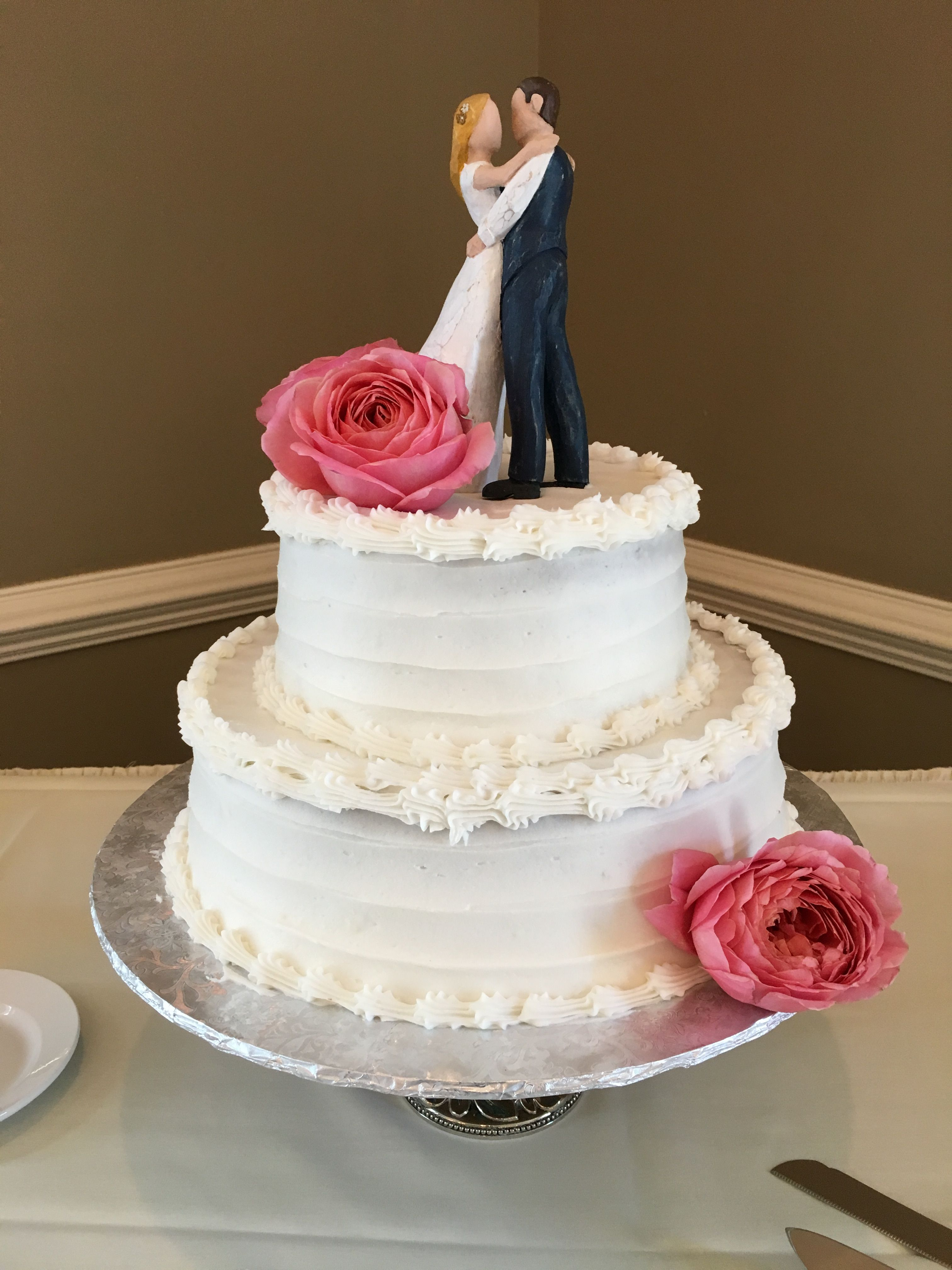 A cute small 2 tier buttercream wedding cake - strawberry champagne ...