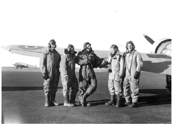 1944 Australian airmen who trained in Canada during World War II. Five airmen in flying gear standing in front of the wing of a plane: P/O Johnstone, Sgt. Walton, Sgt. A.C. Gardner (Kelso, Tas.), P/O E.J. O'Donnell (Devon Park, S. Aust.) and Sgt. R.J. Baxter (Kilkivan, Q'ld.)  http://handle.slv.vic.gov.au/10381/208509