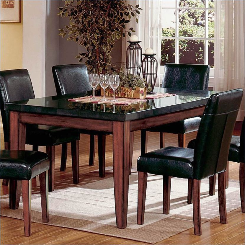 Black granite dining table top looks good in a modern dining room