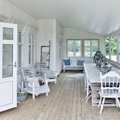 Gorgeous enclosed porch...love all the white!