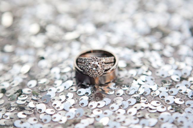 wedding rings on silver sequins