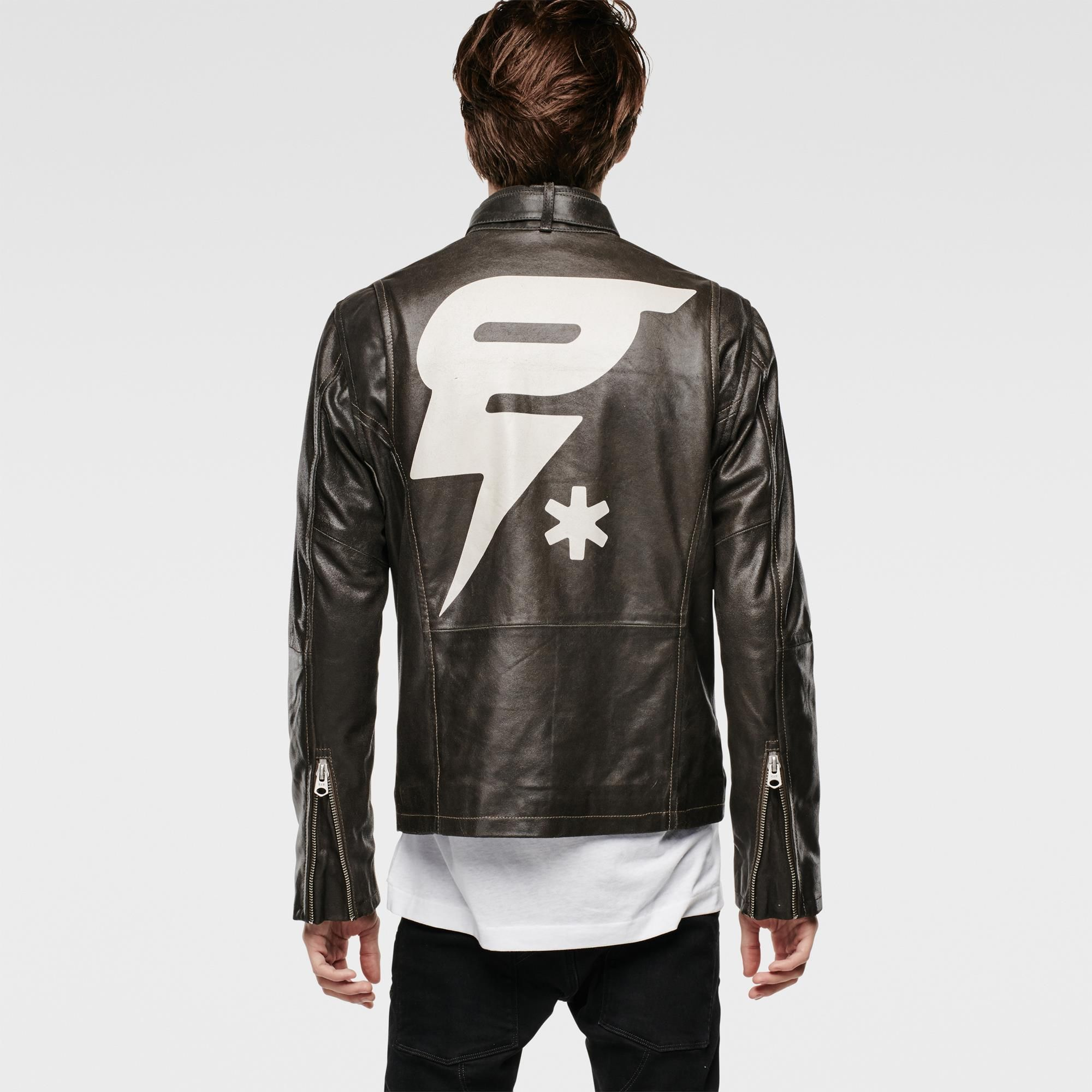 Slim leather jacket with café-racer belted collar and metal hardware. Back features a large painted artwork.