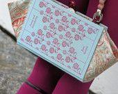 It's a book (cover), it's a purse. It's a great idea.