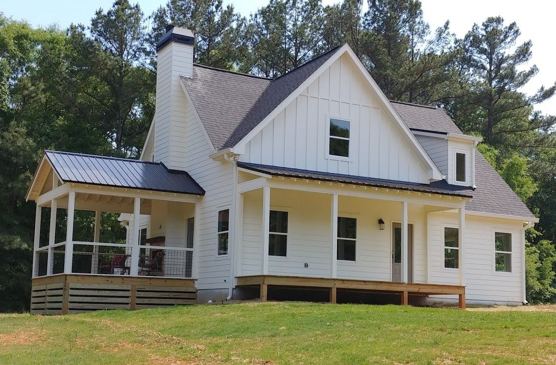 Almost Done Farmhouse Exterior Black Roof With Metal Porches And Dormers Dove White Si Farmhouse Exterior Craftsman Front Porches Vertical Siding Exterior