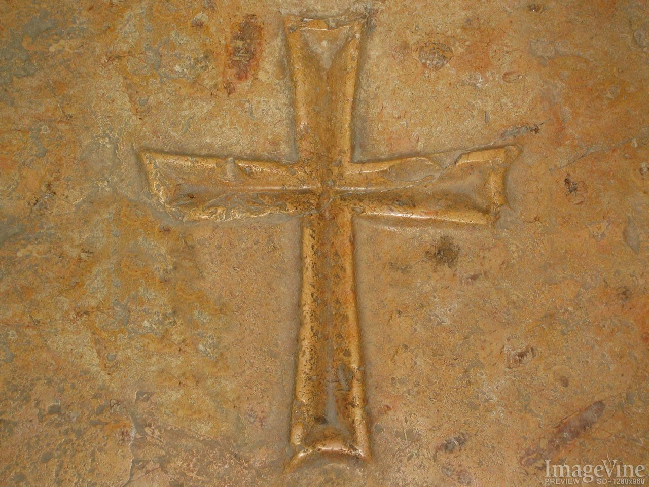 Cross embedded in a Stone Background