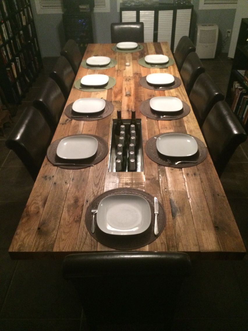 """11'-0"""" long pallet wood dining room table. 2 hidden built-in wine/beer trough with drainage. #wegmaninteriors"""