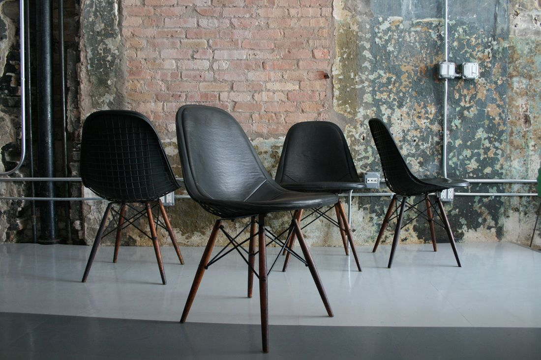 Eames : Wire chairs with Naugahyde covers and Walnut dowel legs