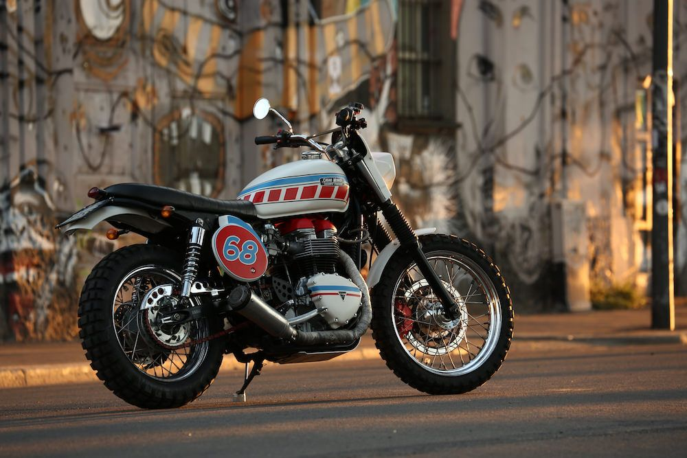 It only takes one glance at this 2001 Triumph Bonneville turned Scrambler to realize this is not your everyday custom Triumph. A creation from Italy-based builders Grease Monkey, it's the red, white and blue color scheme and fiberglass headlight fairing that first catch the eye. Covered in the pages of Silodrome, this build's uniqueness illustrates what they love about the Bonneville. . .