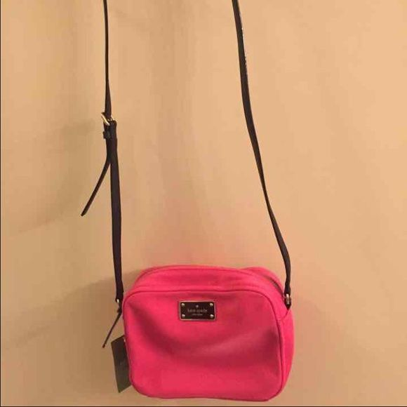 Brand new Kate Spade Crossbody Brand new, never used, with tags. Color is cabaret pink. Style is crossbody. Purchased for full price. The strap is black and adjustable. Material of purse is fabric.  Kate Spade crossbody with gold toned hardware Top zip closure Adjustable strap with maximum drop of approx. 21.5 inches Interior features 1 zip pocket and 1 slip pocket Approx. dimensions: 8 in L x 5.75 in H x 2.75 in W kate spade Bags Crossbody Bags