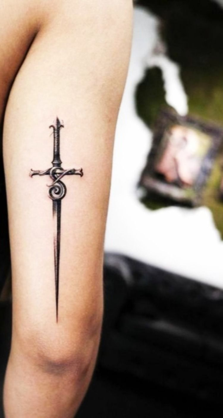 Top 50 Tattoos With Meanings Sword Tattoo Sword Tattoo Sword Tattoos For Women Tricep Tattoos