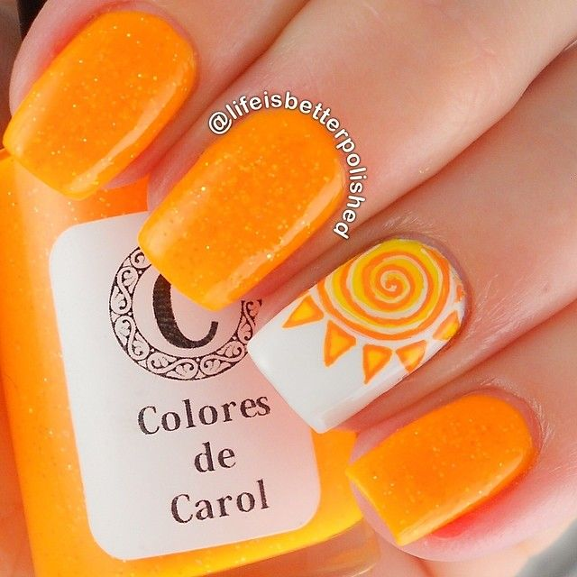 Swirly orange and yellow sun nail art - Cute Summery Nail Design. I Like The Index Finger Design And The