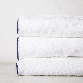 Soft, plush and absorbent Egyptian cotton terry with a contrasting color piped trim.