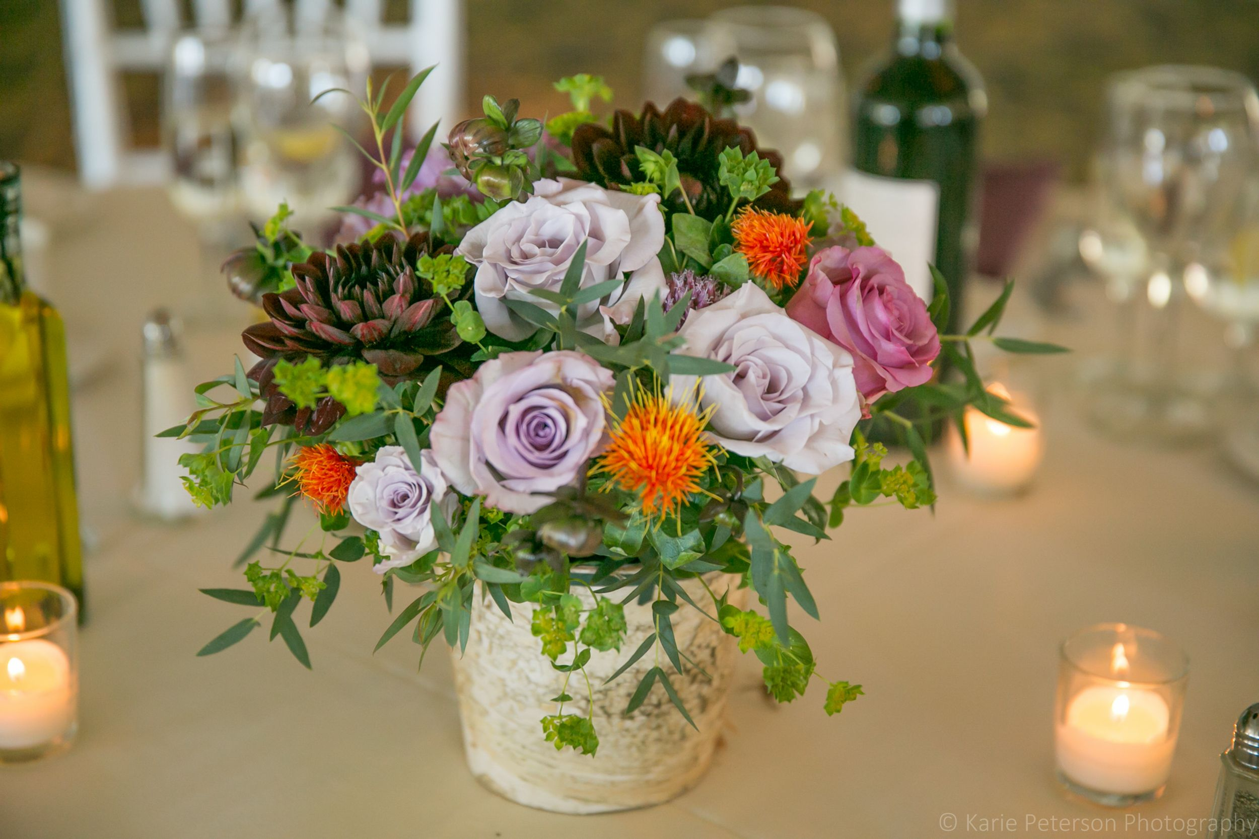 Table centerpiece purple and orange flowers Photography