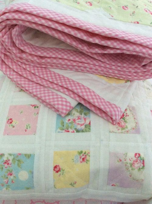 Pink gingham border on Flower Garden quilt, and square-in-a-square pillow case to match.  adaisygarden.com