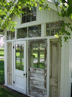 a garden house from recycled doors and windows