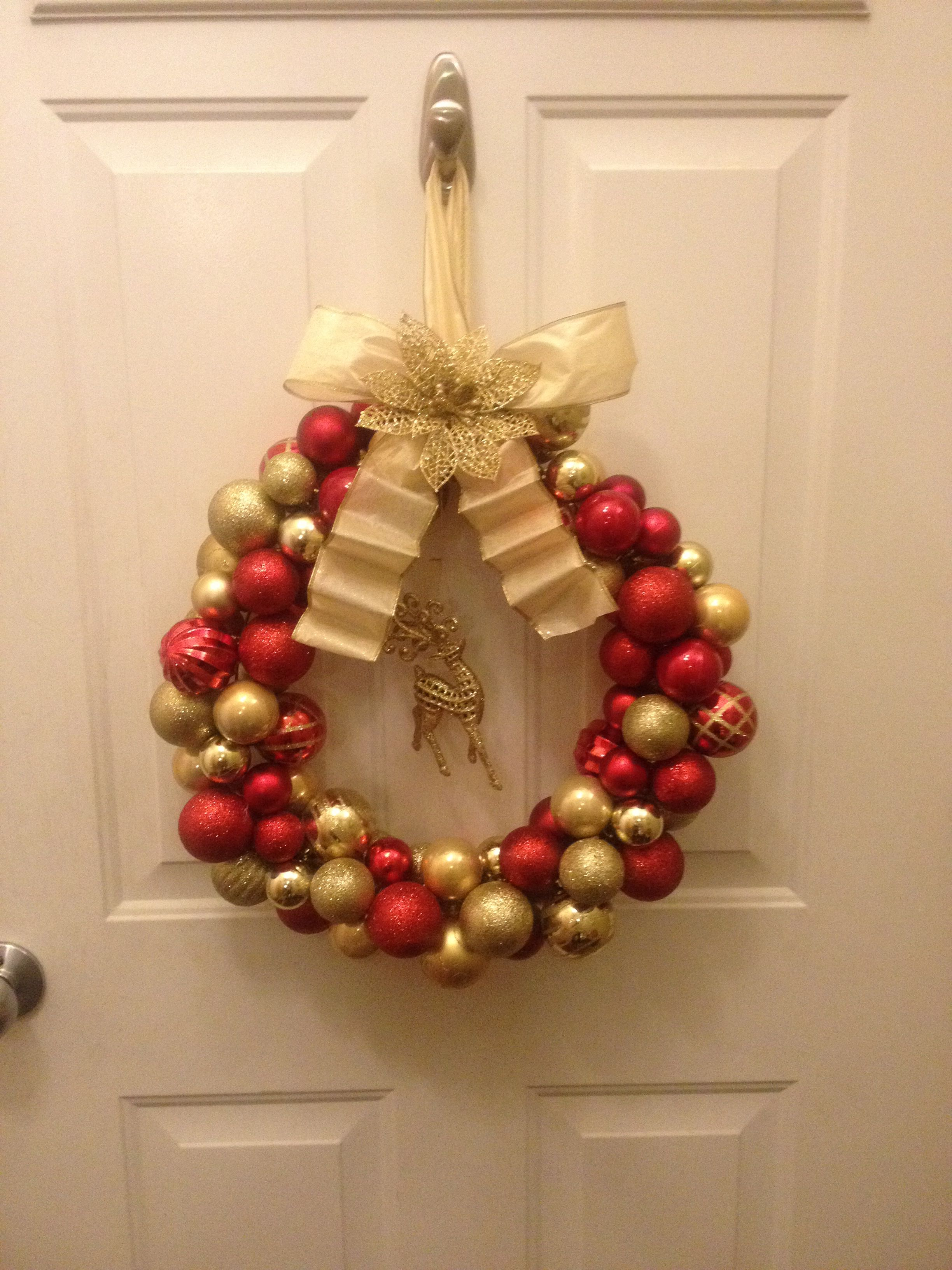 Dollar Tree Christmas Ornament Wreath made with a wire