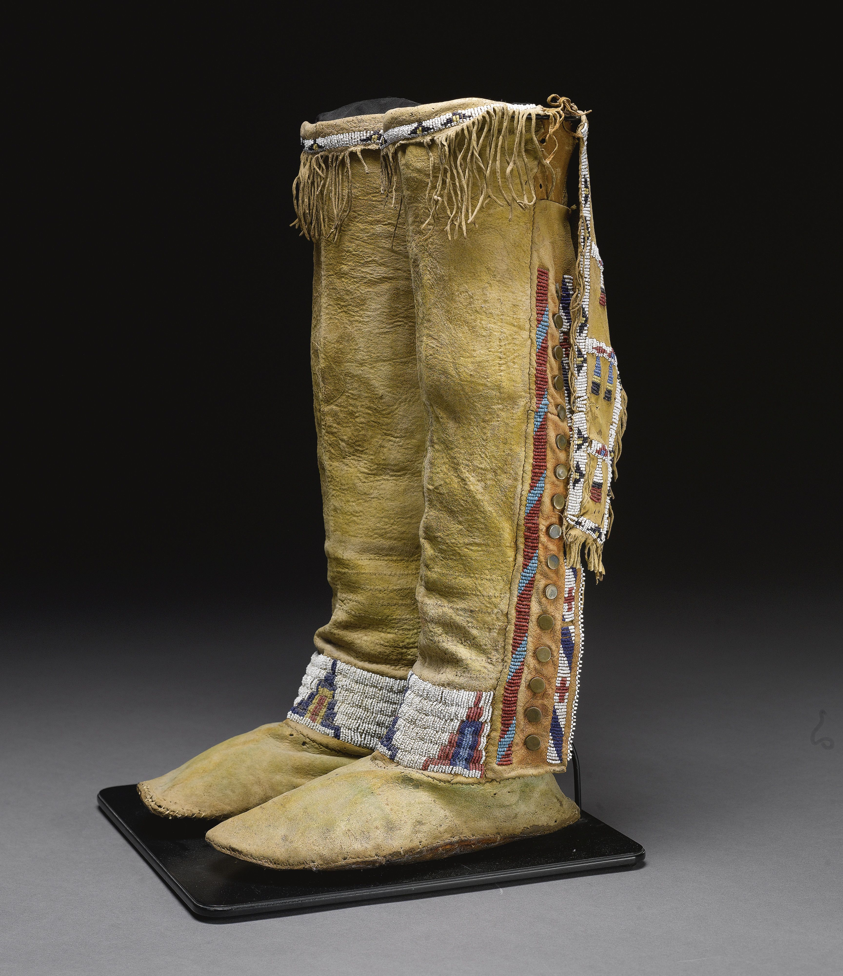 Pair of cheyenne beaded and fringed hide high top for Cheyenne tribe arts and crafts