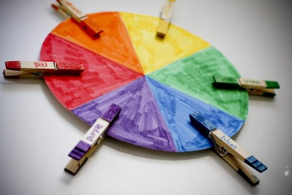Cognitive Development CD57.  The older toddler matches and sorts according to color, size, shape or size.  The older toddler can match the clothespins to it corresponding color on the wheel.