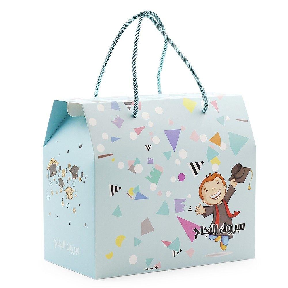 علبة لتقديم هدايا وتوزيعات التخرج للأولاد عبارة مبروك التخرج الطول 23 سم العرض 13 2 سم الارتفاع 20 سم متوفرة لدى موقع صفقات Toy Chest Decor Container
