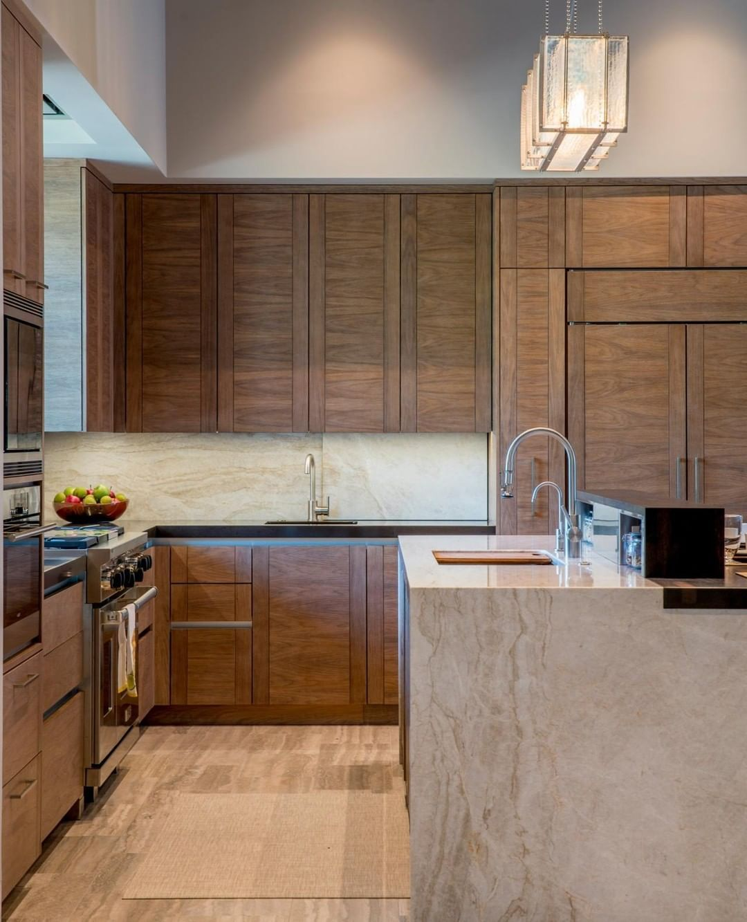 Dering Hall On Instagram A Desert Kitchen With Modern Walnut Cabinets And A Waterfall Island By Coope Walnut Cabinets Walnut Kitchen Walnut Kitchen Cabinets