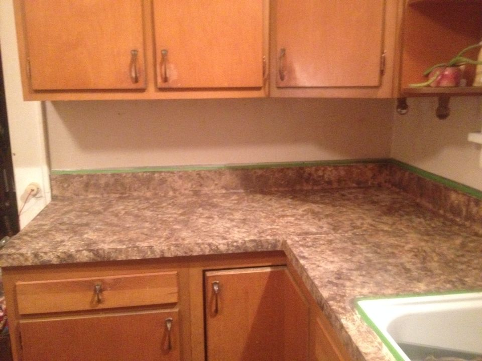 My kitchen counter tops painted to look like granite..love ...