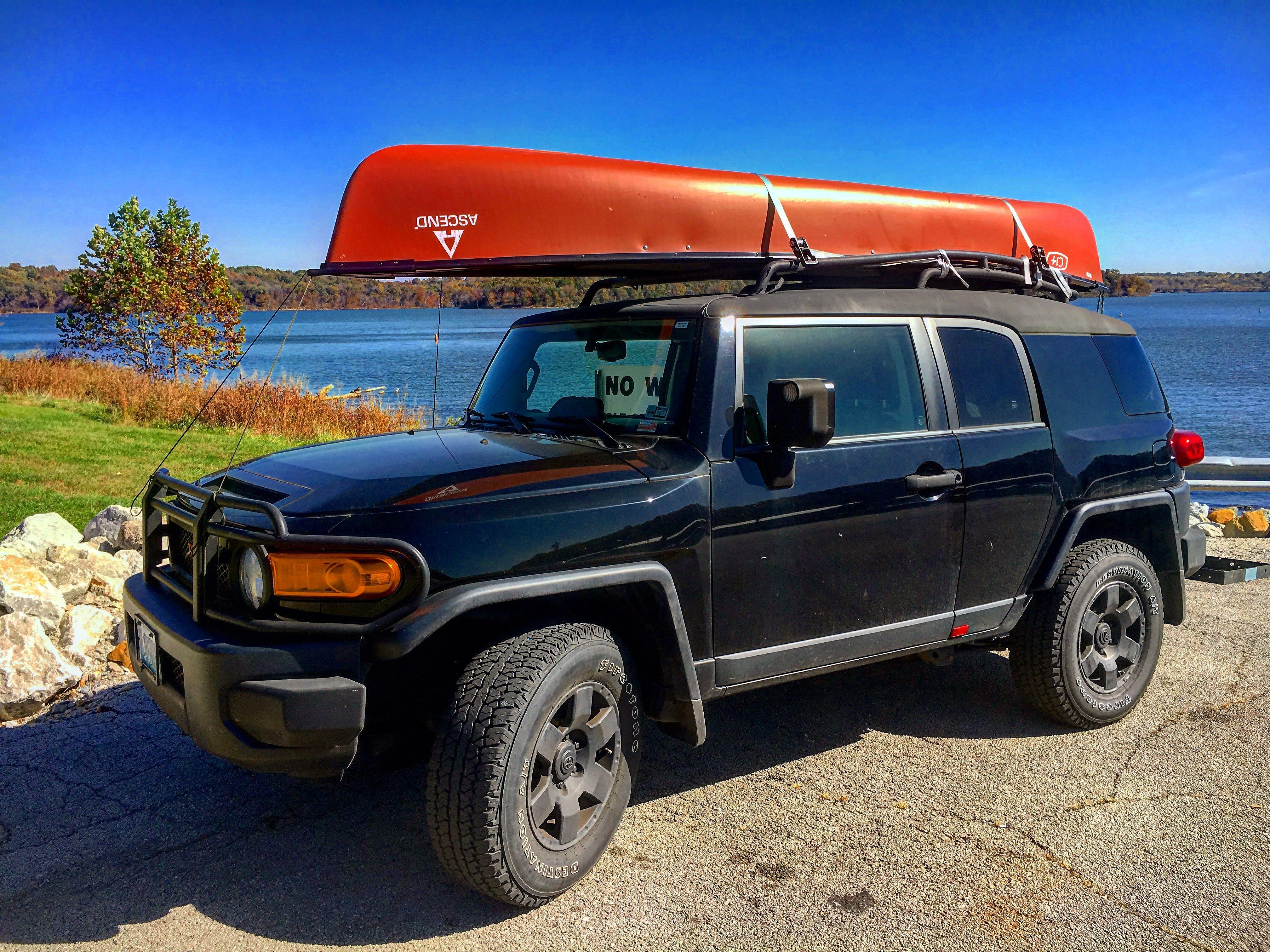 FJ cruiser taking the canoe for more adventures.