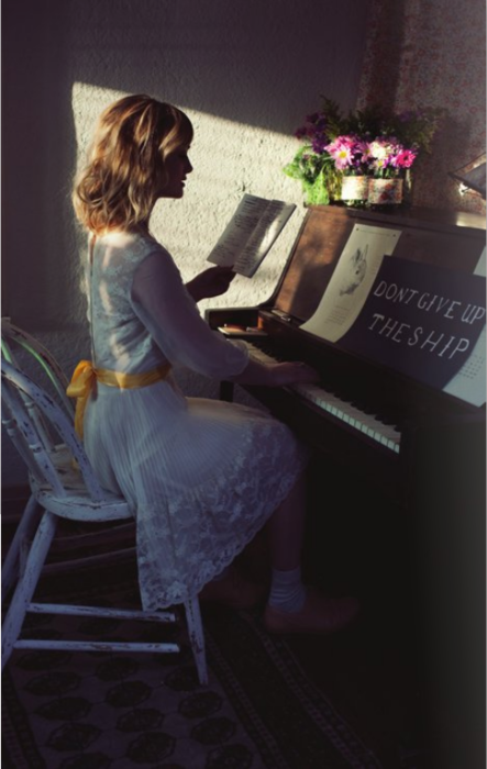 Alison Sudol playing the piano