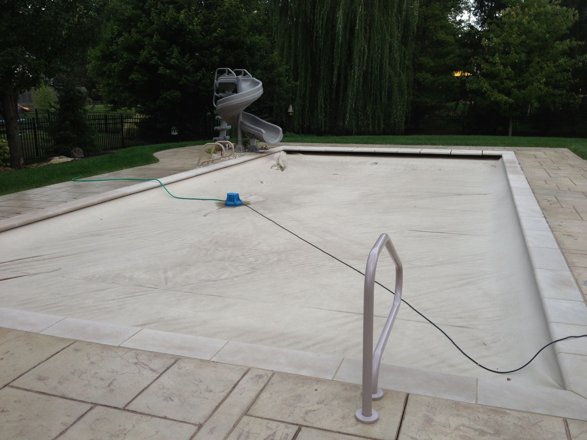 Stamped concrete pool deck out back pinterest for Concrete pool