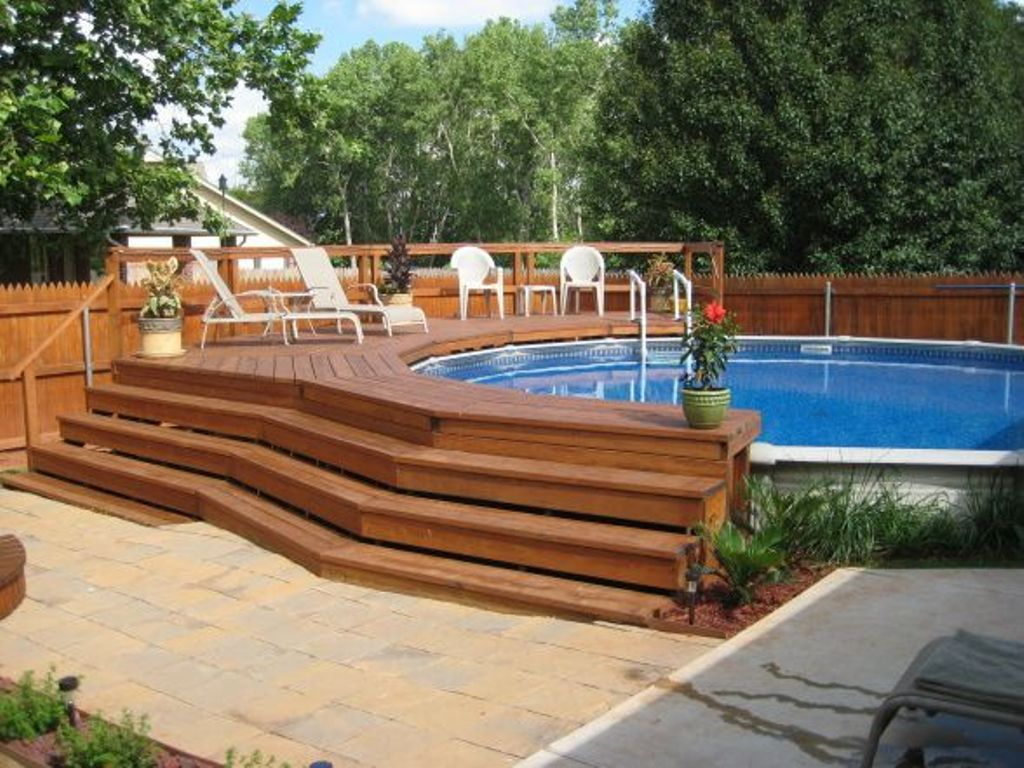 Swiming pools pool deck with wooden tile also above ground for In ground pool deck ideas