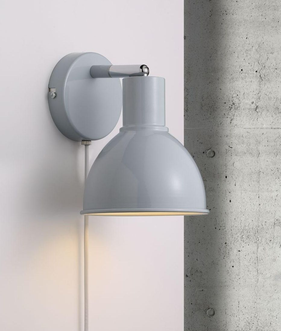 Metal adjustable wall mounted spotlight in a postwar factory factory