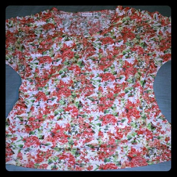 Floral top with rhinestones Soft pastel floral colors. Rhinestones around the neckline. Rouching at top of sleeves for extra detail. Kim Rogers Tops