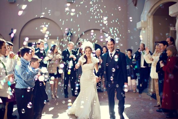 Weddings Ask The Kids Adults To Blow Bubbles As Bride Walks Down
