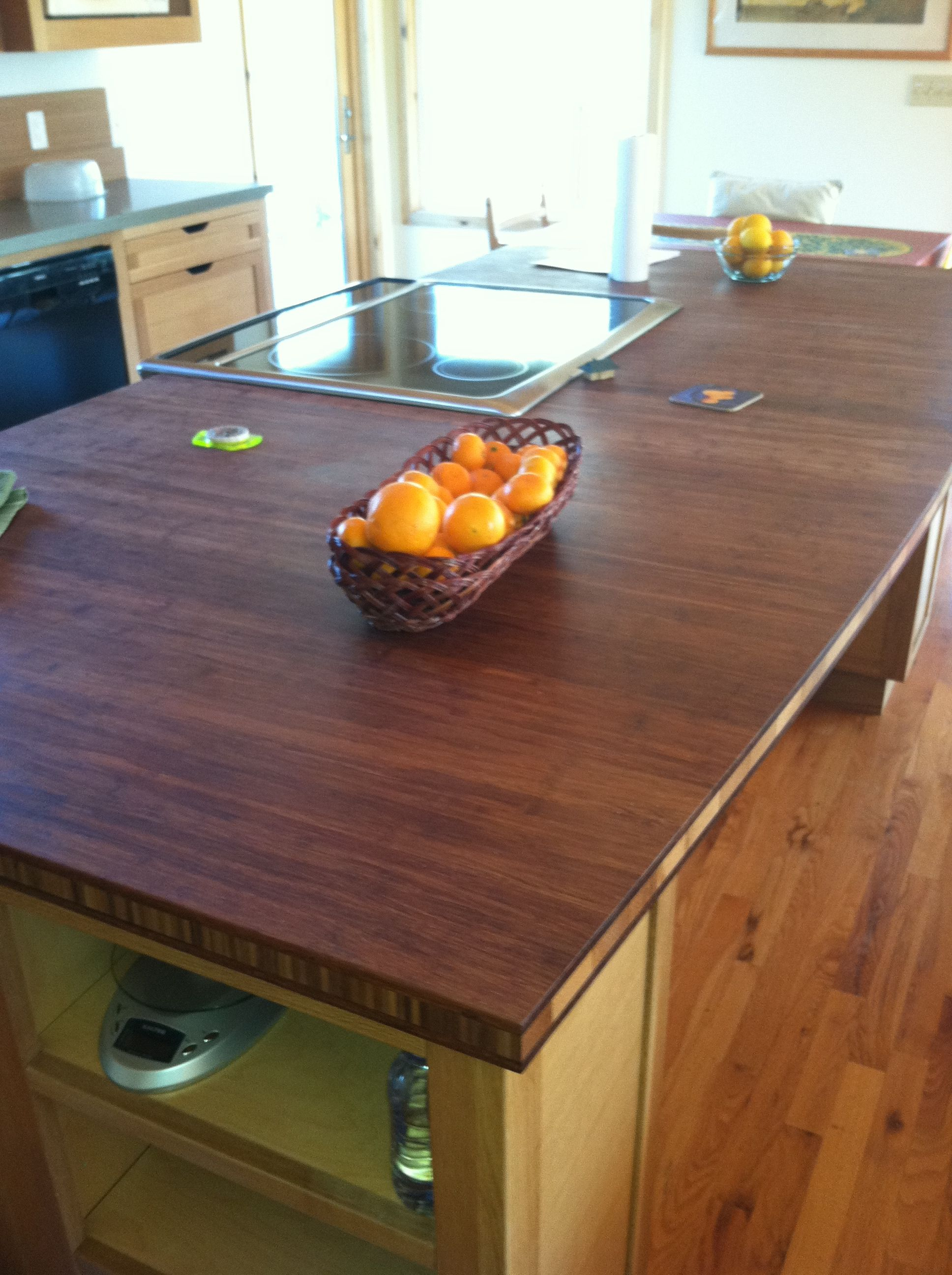 Strand Woven Bamboo Counter Top Material Used For This Island Top Is A Focal Point In This Eco Friendly Kitchen Sustainable Building Materials Kitchen Remodel
