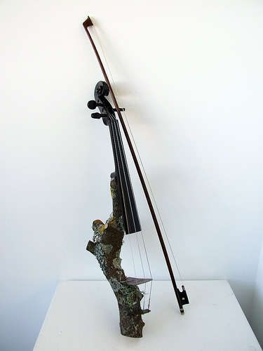 This is an electric violin made from a log! It is amazing!