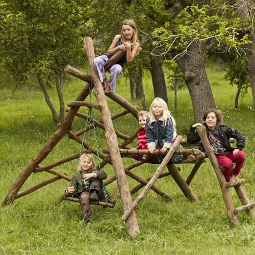 wooden jungle gym with swings... we should put something like this together at the campground for the kiddos