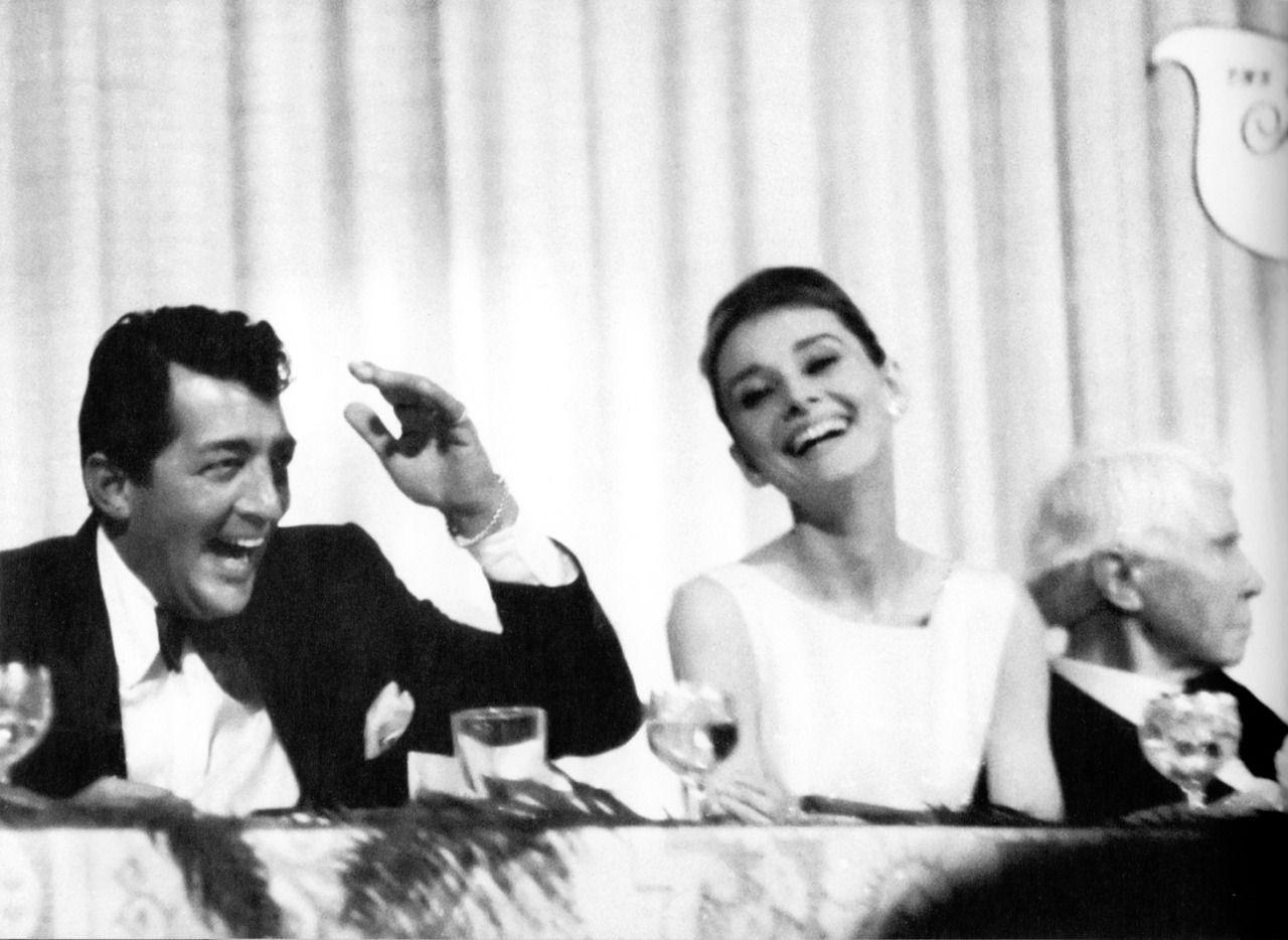 "rareaudreyhepburn: "" Dean Martin, Audrey Hepburn, and poet Carl Sandburg at a Friars Club banquet at the Beverly Hills Hotel, 1961. """