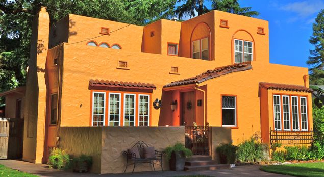 Mission Revival style with an adobe style stucco exterior and tile