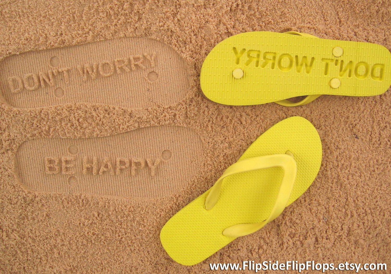 23e52ccc9db535 Don t Worry Be Happy - Sand Imprint Flip Flops.   19.95
