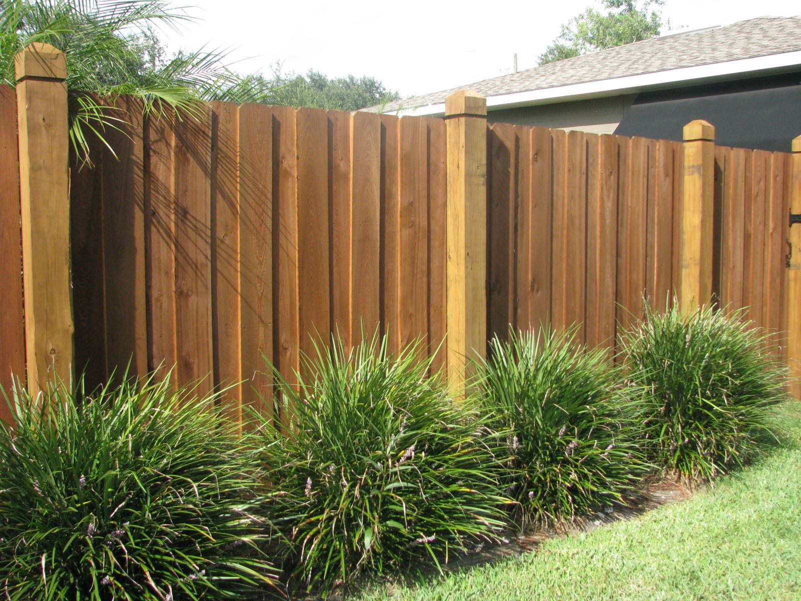 Custom wood privacy fence with caps by Mossy Oak Fence