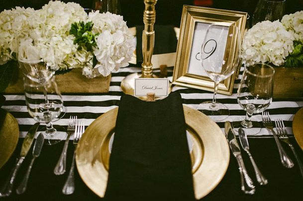 wedding reception tables decorated in black and white and gold ...