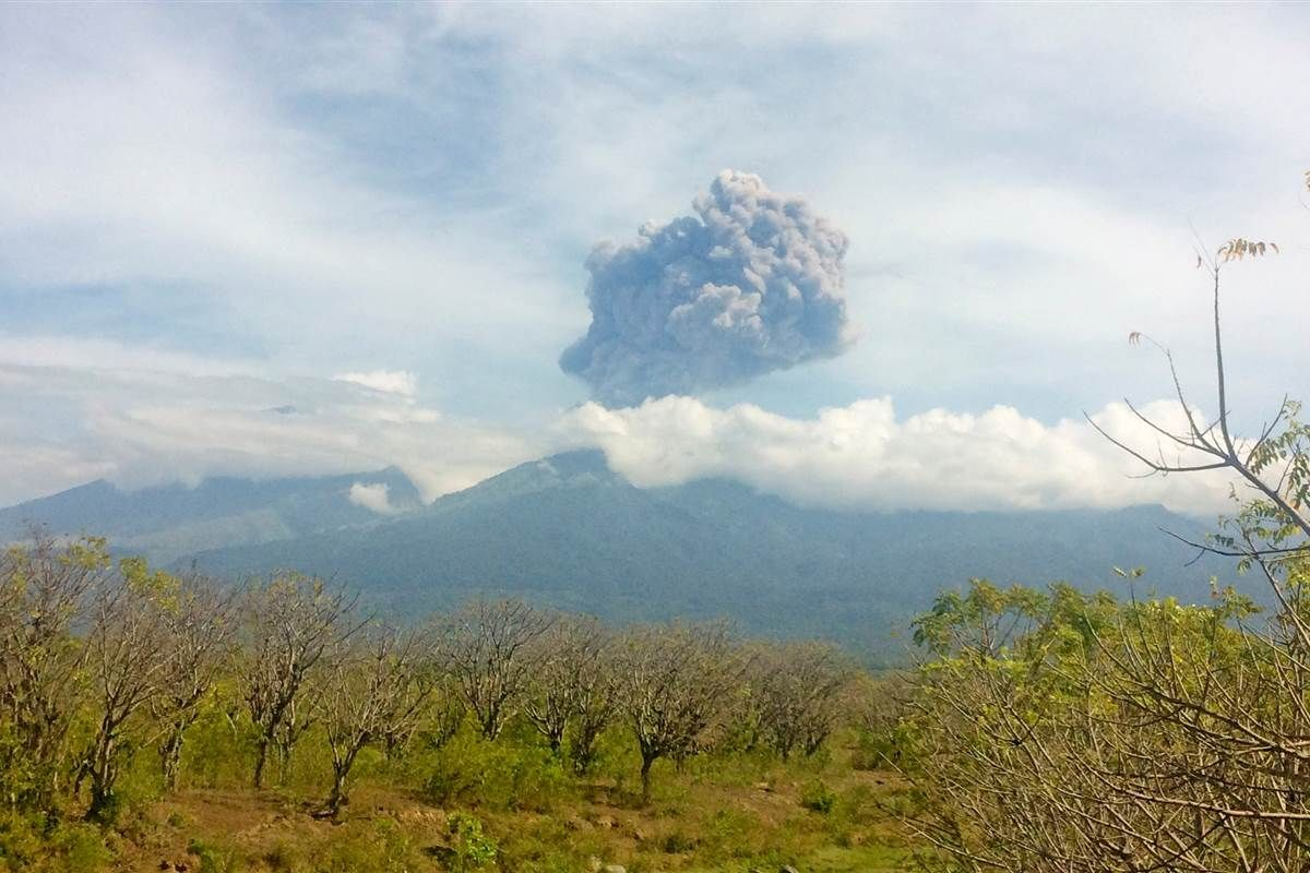 Hundreds of tourists are trapped on an erupting volcano in