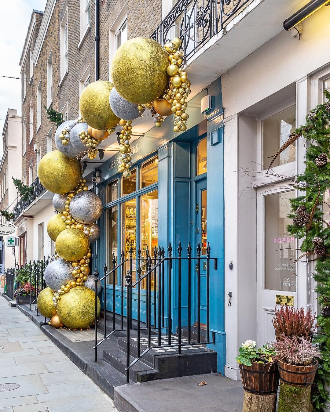Big Silver And Gold Baubles On A Shopfront In London S Belgravia At Christmas This Beautiful Christmas Decorations London Christmas Fun Christmas Decorations