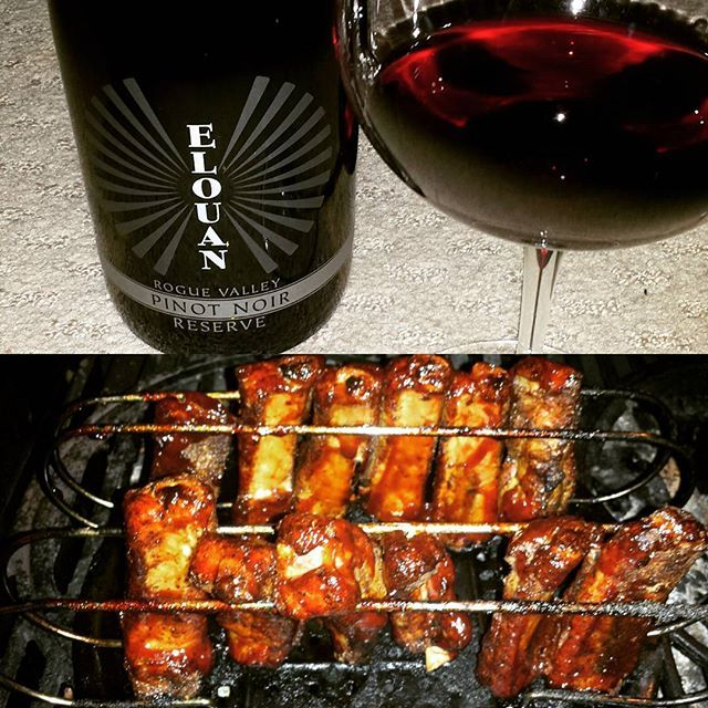 "Happy Sunday-Wine-Funday!  Tonight we're enjoying a fantastic bottle of 2015 Elouan Pinot Noir Reserve from Rogue Valley in Oregon, and we paired it with succulent Pork BBQ Ribs. This is a highly recommended ""mouth watering"" pairing to try on your next get together with friends & family.  Live The Wine Lifestyle 🍷🍷🍷 #wine #winenight #winetime #winelife #winelifestyle #wineculture #instajonwine #instawine #pinotnoir #roguevalley #oregon #elouan #bbq #bbqribs #sundaywineday #sundayfunday…"