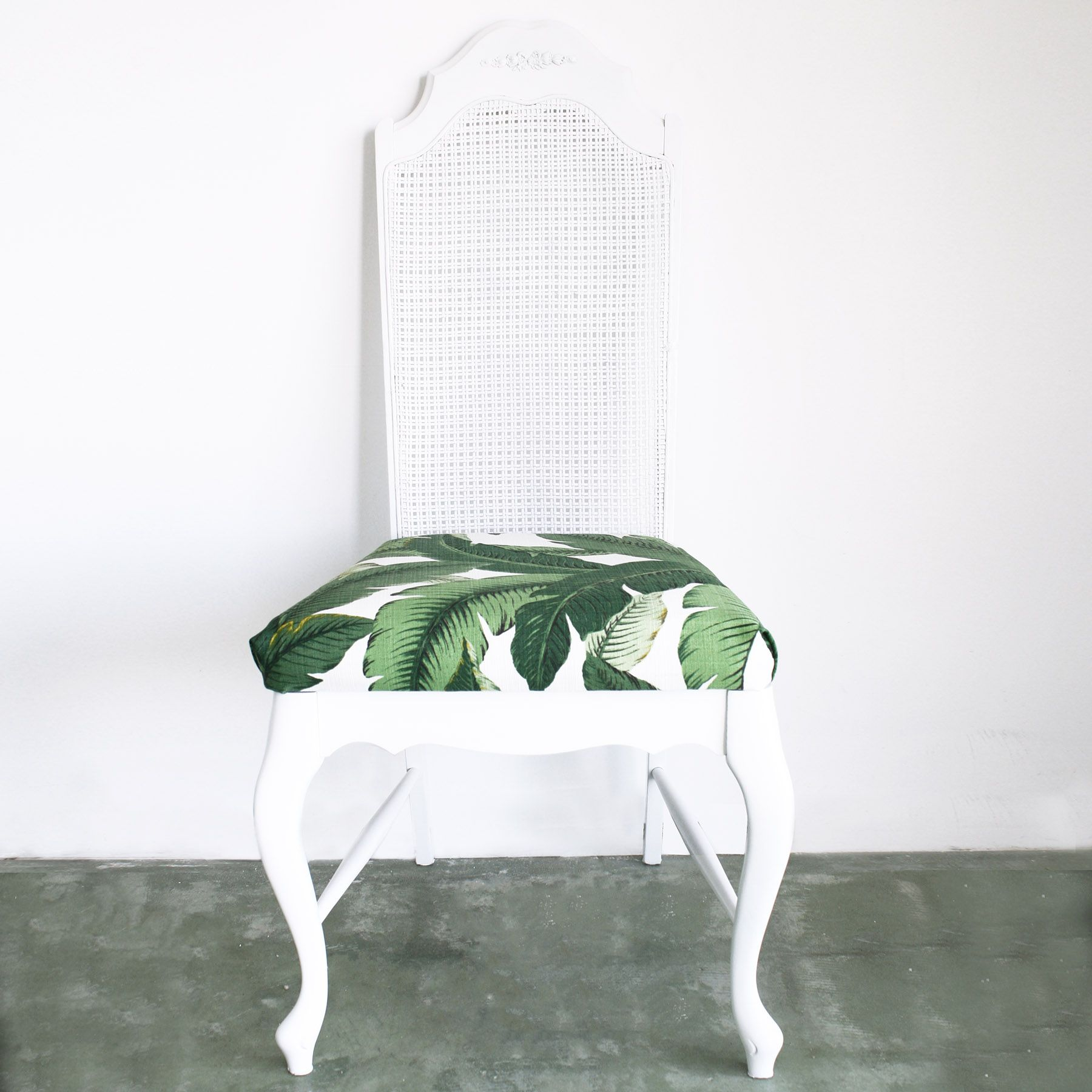 Image result for rattan with banana leaf prints armchair
