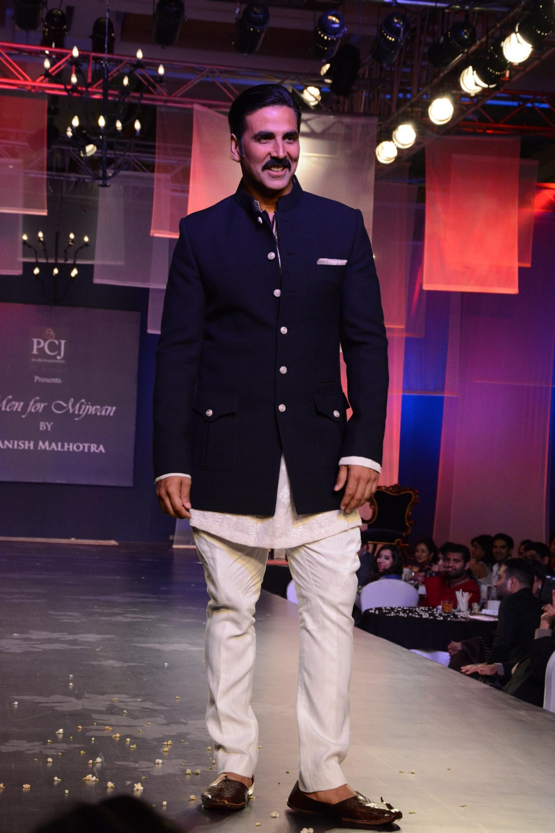 Actor akshay kumar displays the creations of fashion designer manish