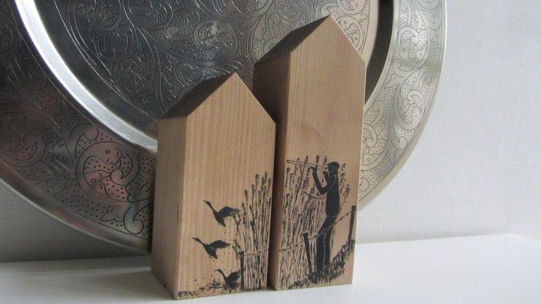 Huisjes met afbeelding van een eendenjager.
