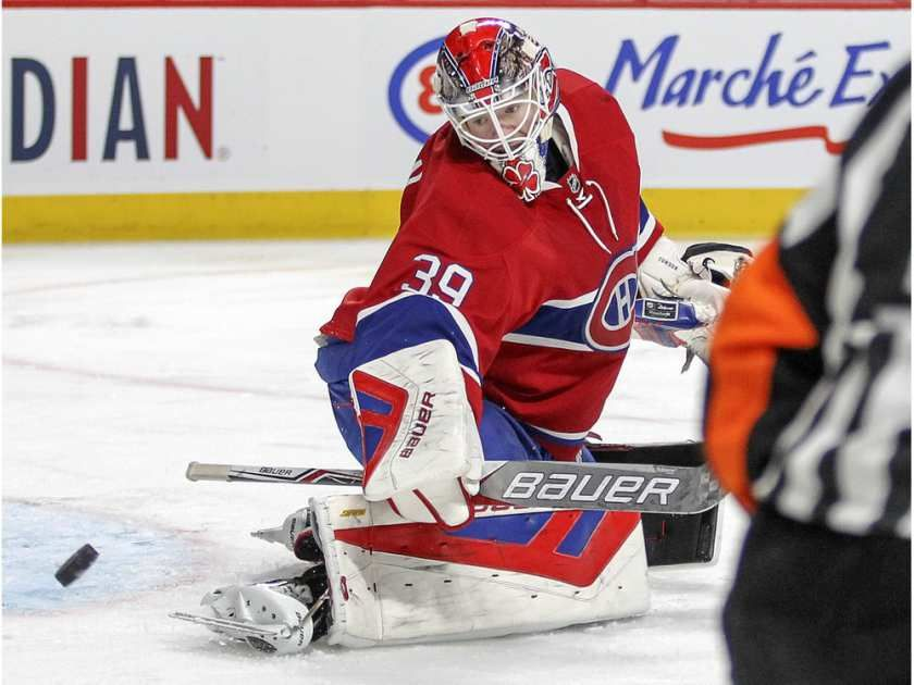 Montreal Canadiens goalie Mike Condon directs the puck toward the corner  during second period of National Hockey League game against the Columbus Blue Jackets in Montreal Tuesday December 1, 2015.