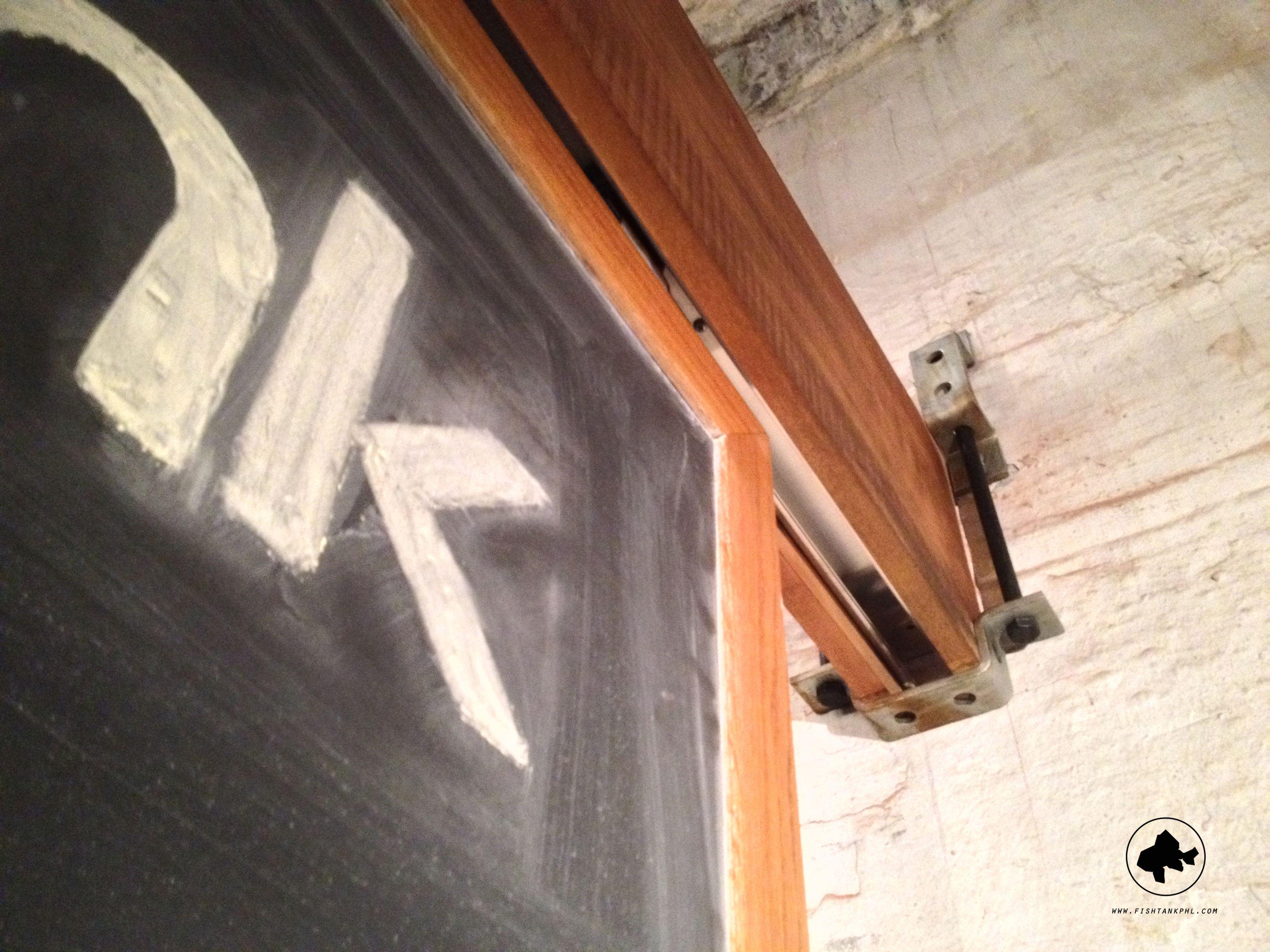 Chalkboard sliding door room divider using pocket door
