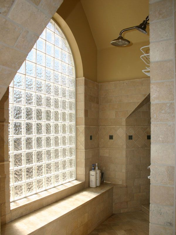 Traditional Bathroom With Arched Window With Glass Block
